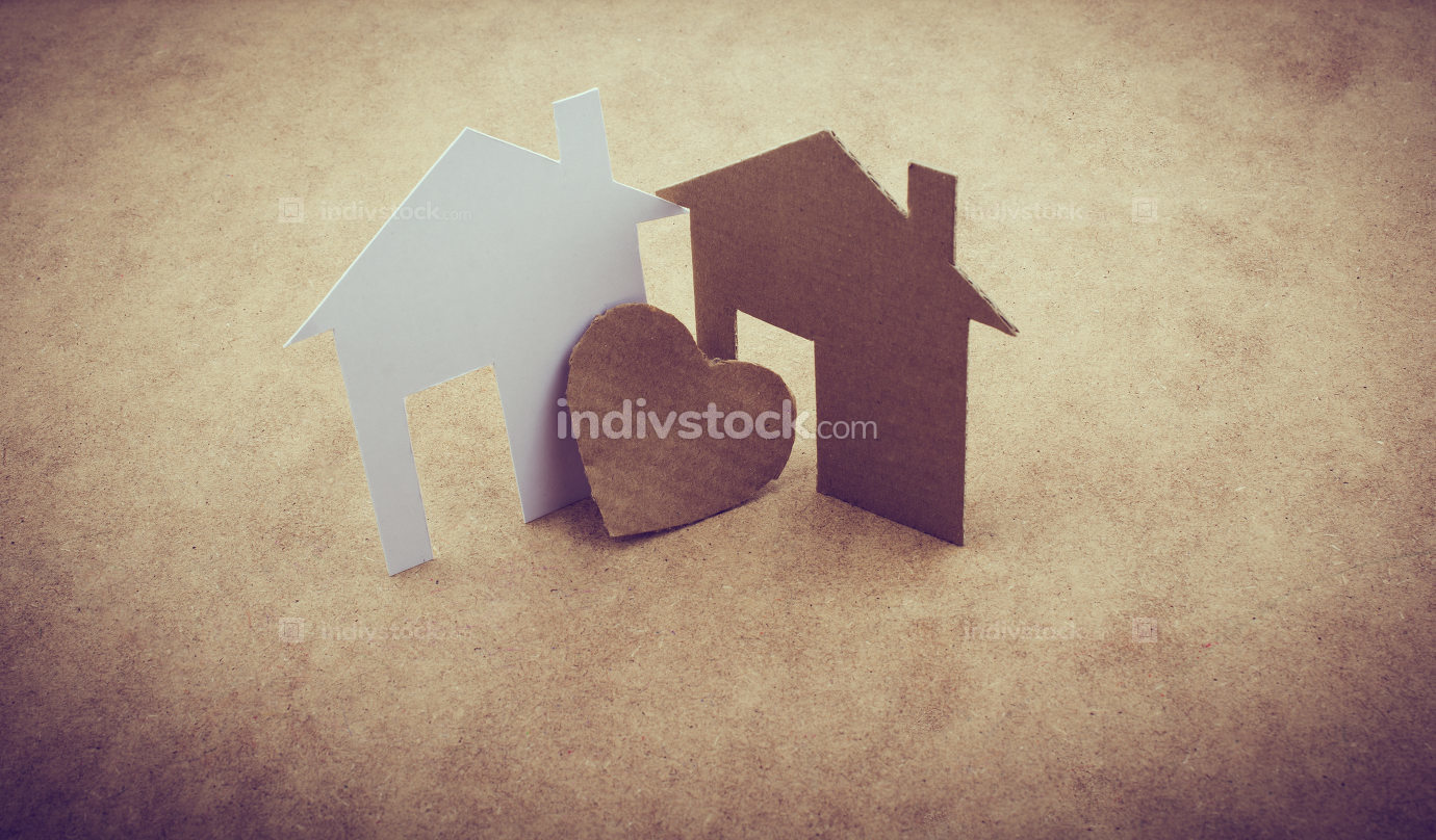 Heart shaped icon and paper houses