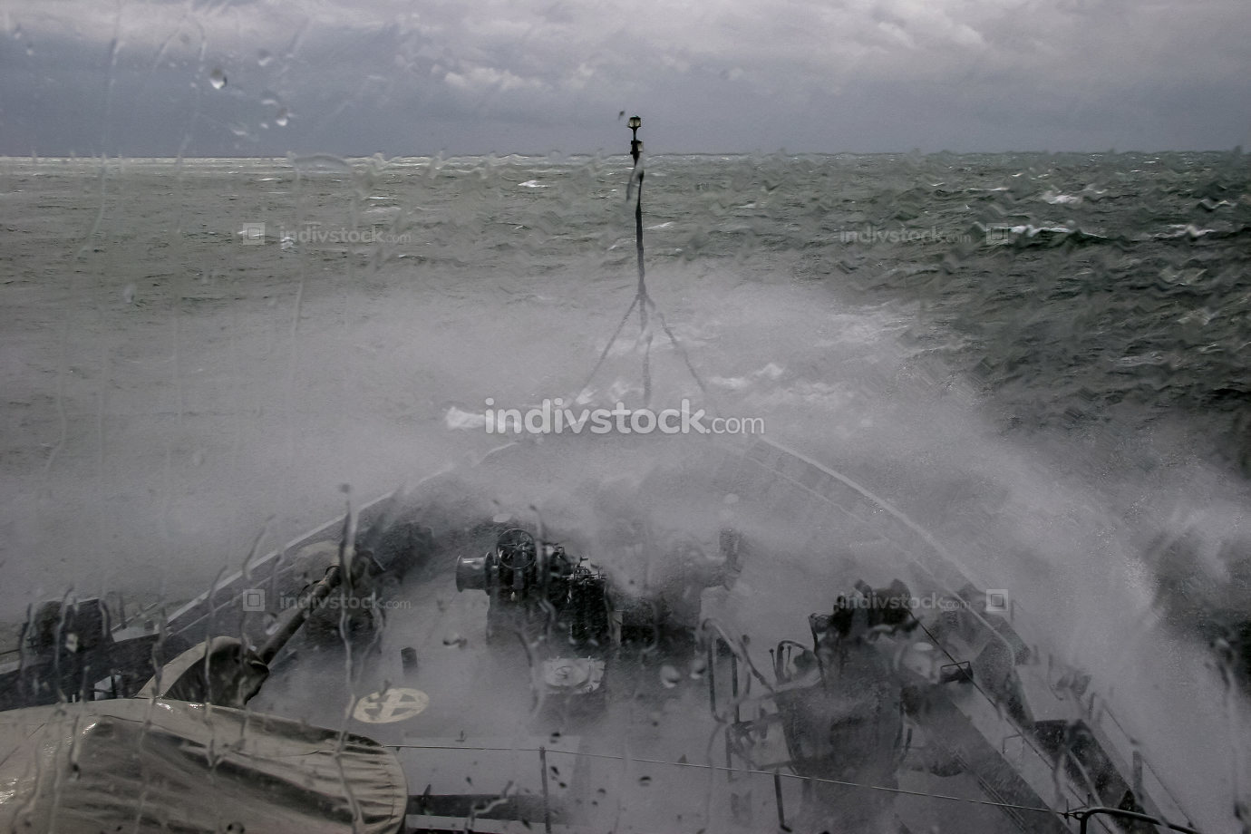 NATO military ship at sea during a storm.