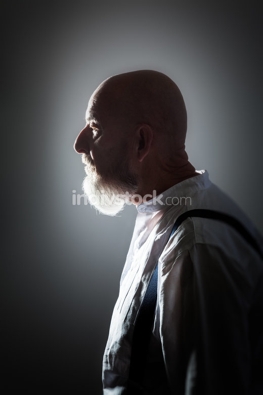 old man portrait back lit