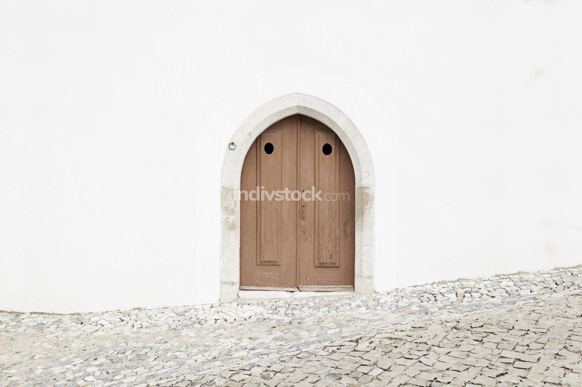 Old wooden door in a church