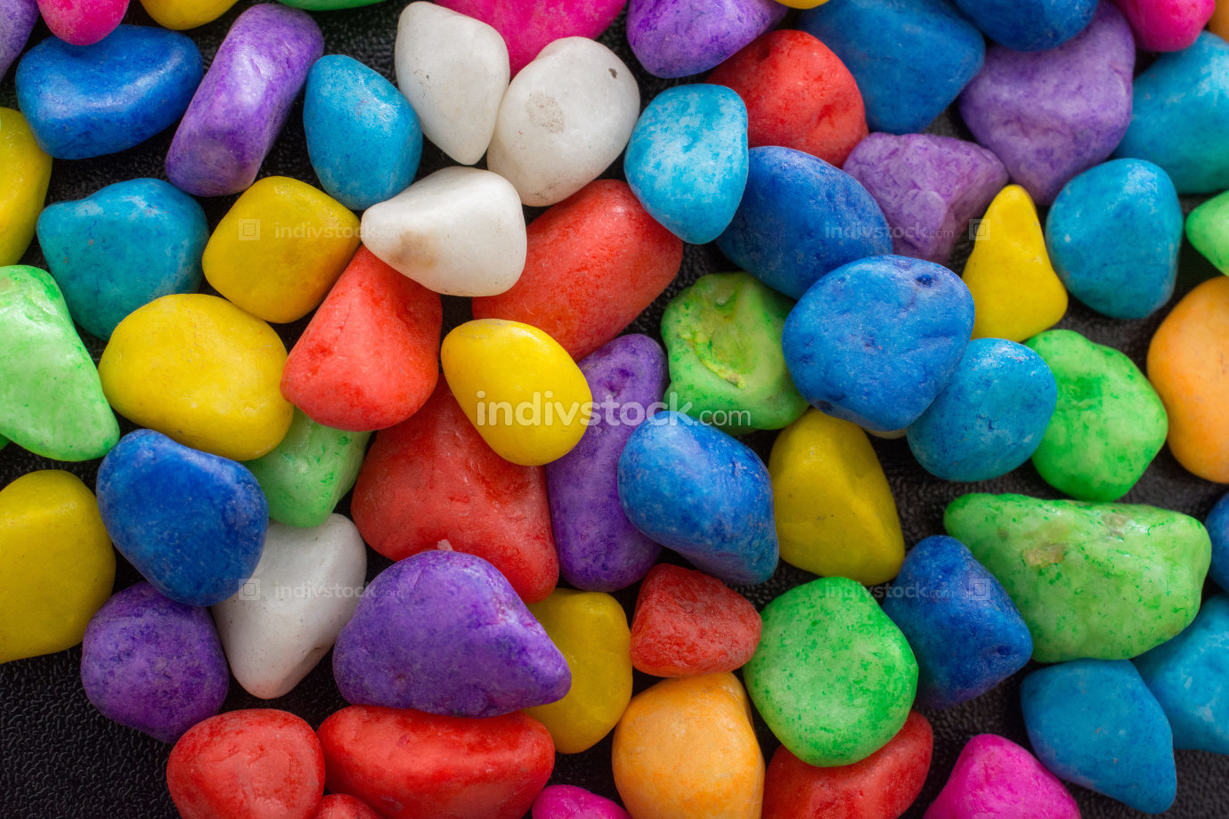 Pile of colorful pebbles as a stone background