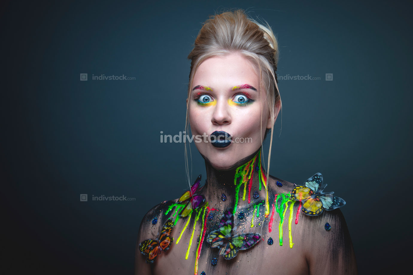Young girl with creative makeup with butterflies