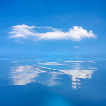 blue sky with white cloud over the sea