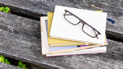 books and reading glasses