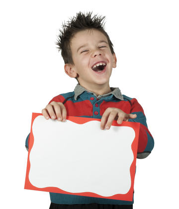 Boy who laughs and holds white board