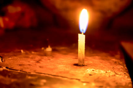 Candle spreading light isolated on blur background