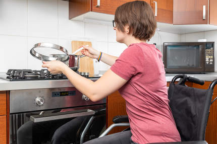 disabled woman cooking in the kitchen