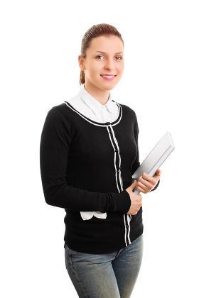 Girl in uniform holding books