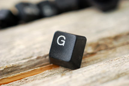 letter g keyboard buttons on old wood background