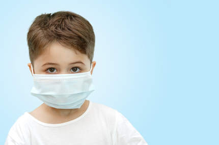Caucasian boy in medical mask on isolated background