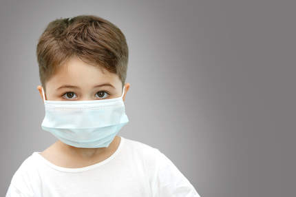 little Caucasian boy in medical mask on isolated background