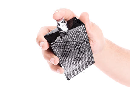 Male hand holding a black perfume bottle