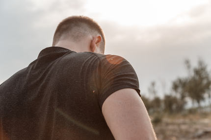 portrait of a young Caucasian guy in a black t-shirt and black s