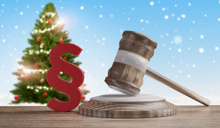 red paragraph and judge gavel in front of a winter background 3d