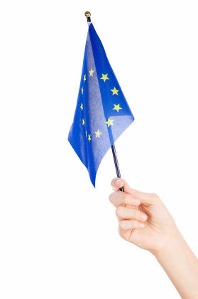 Woman hand waving the flag of European union