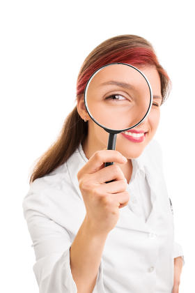 Young doctor looking through a magnifying glass