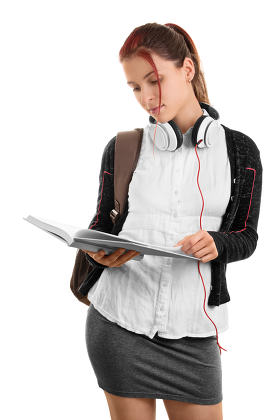 Young girl going through her notes