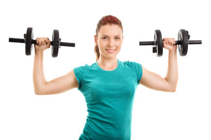 Young girl lifting two dumbbells