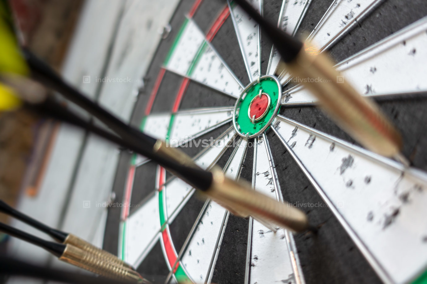 a typical darts game with no dart in the bullseye