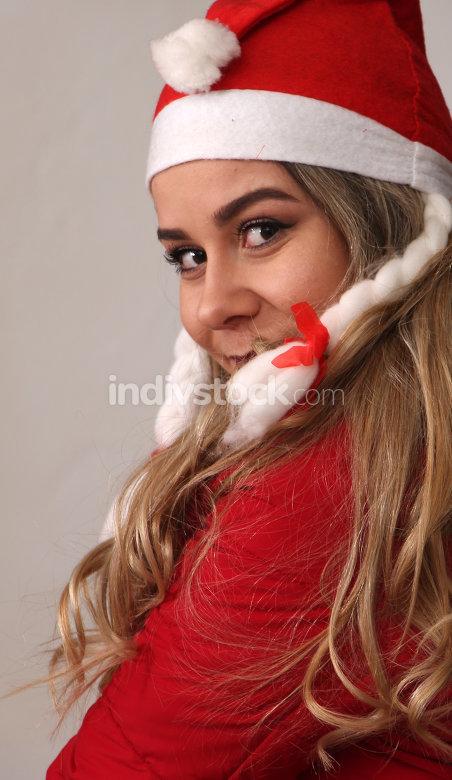 beautiful girl with santa hat , in studio
