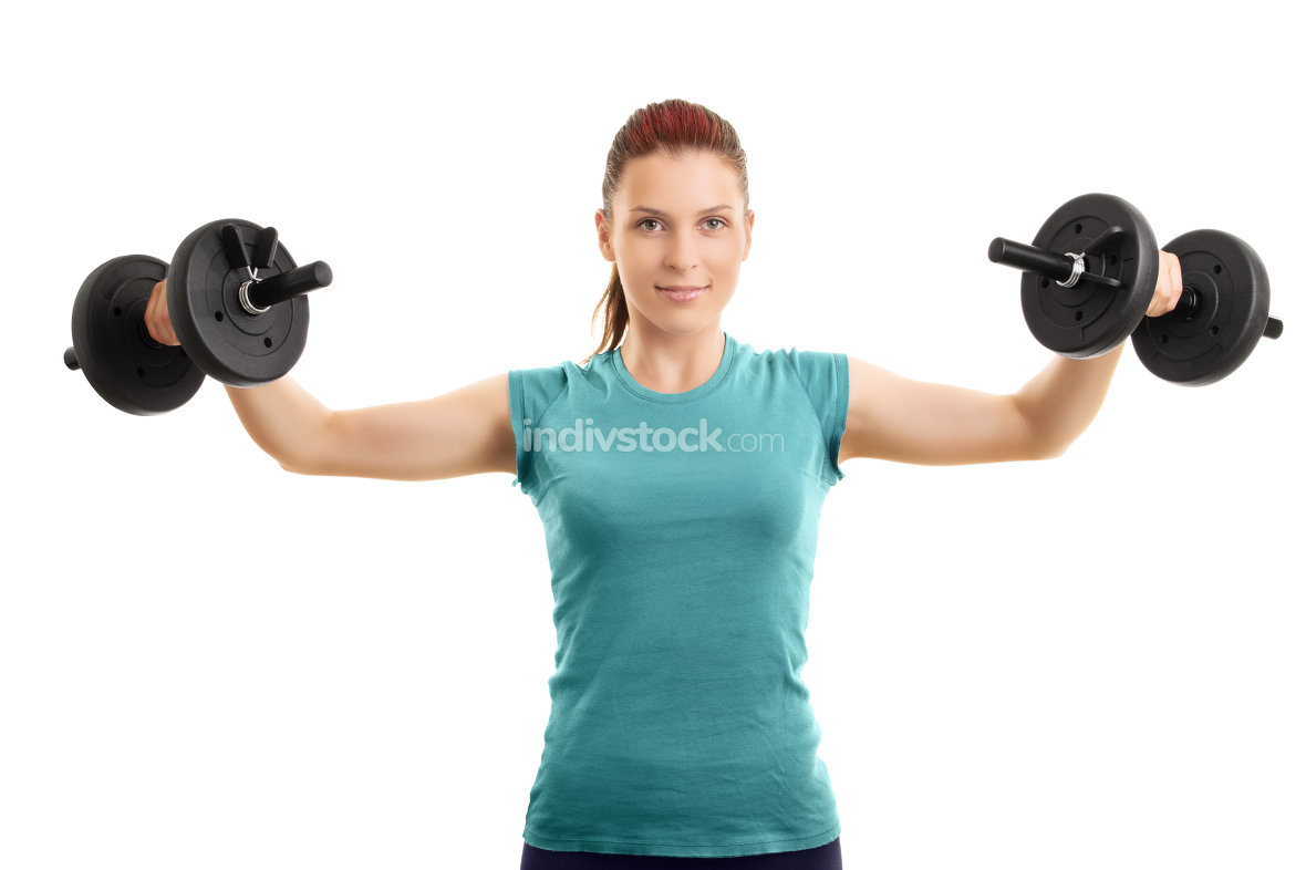 Beautiful girl working out with a set of dumbbells