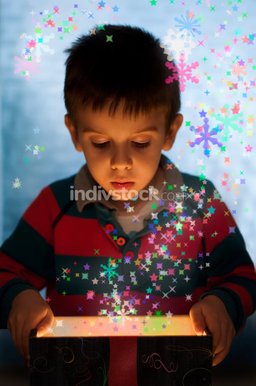 Child peeping in a gift box
