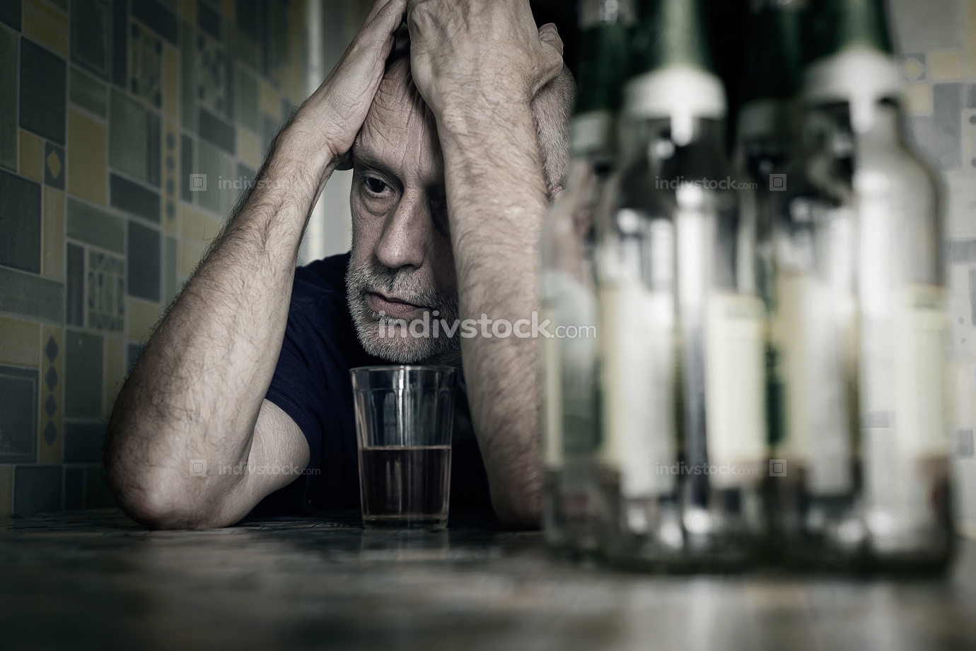 Desperate man falling into depression and becoming alcoholic