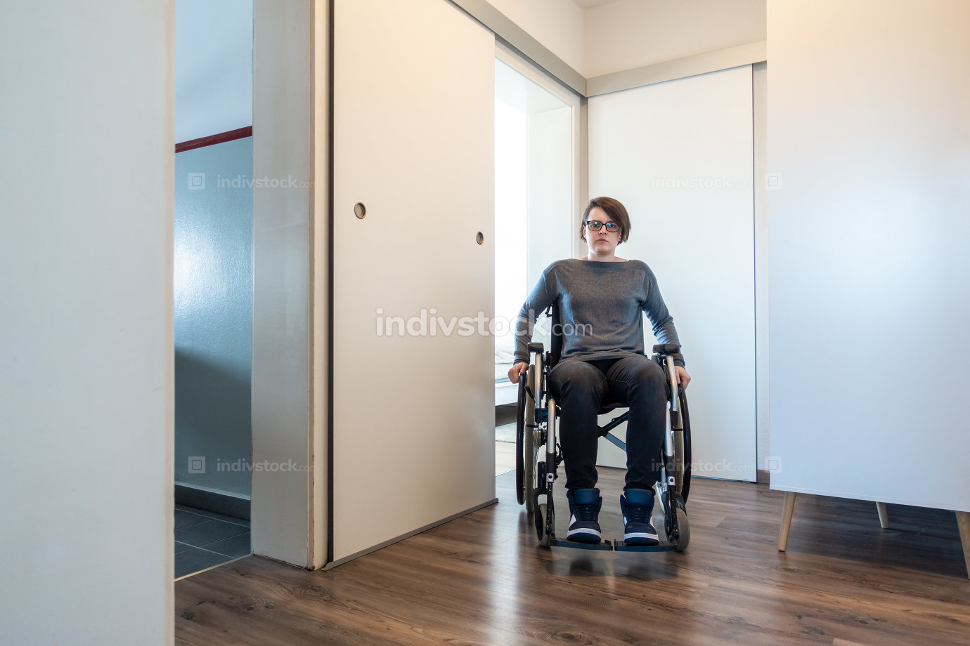 disabled woman in her apartment