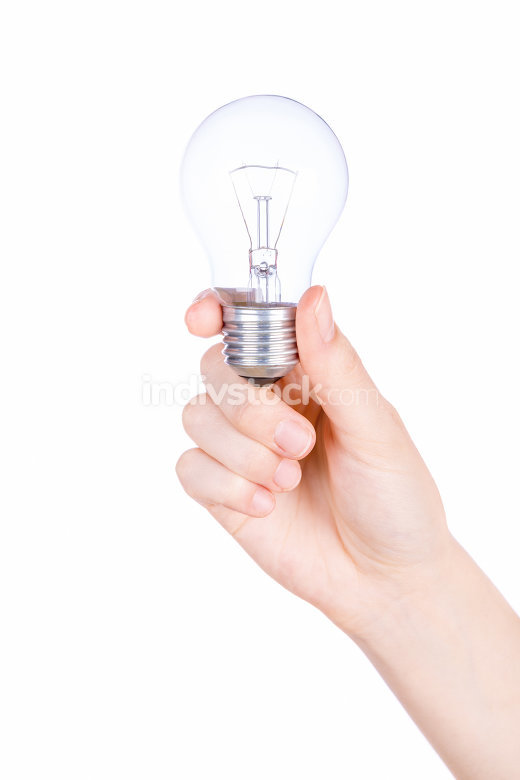 Female hand holding a light bulb