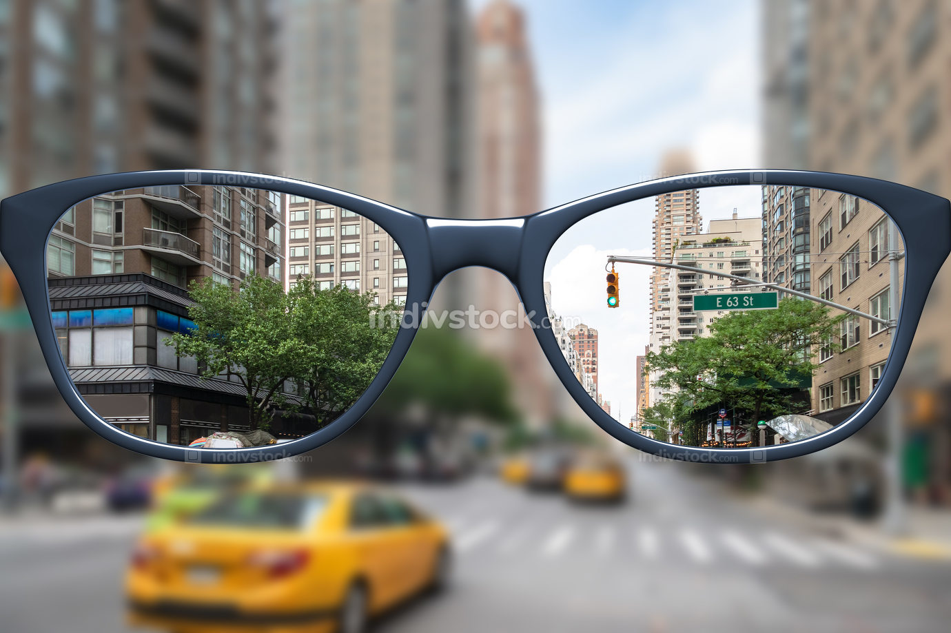 glasses with sharp and blurred big city