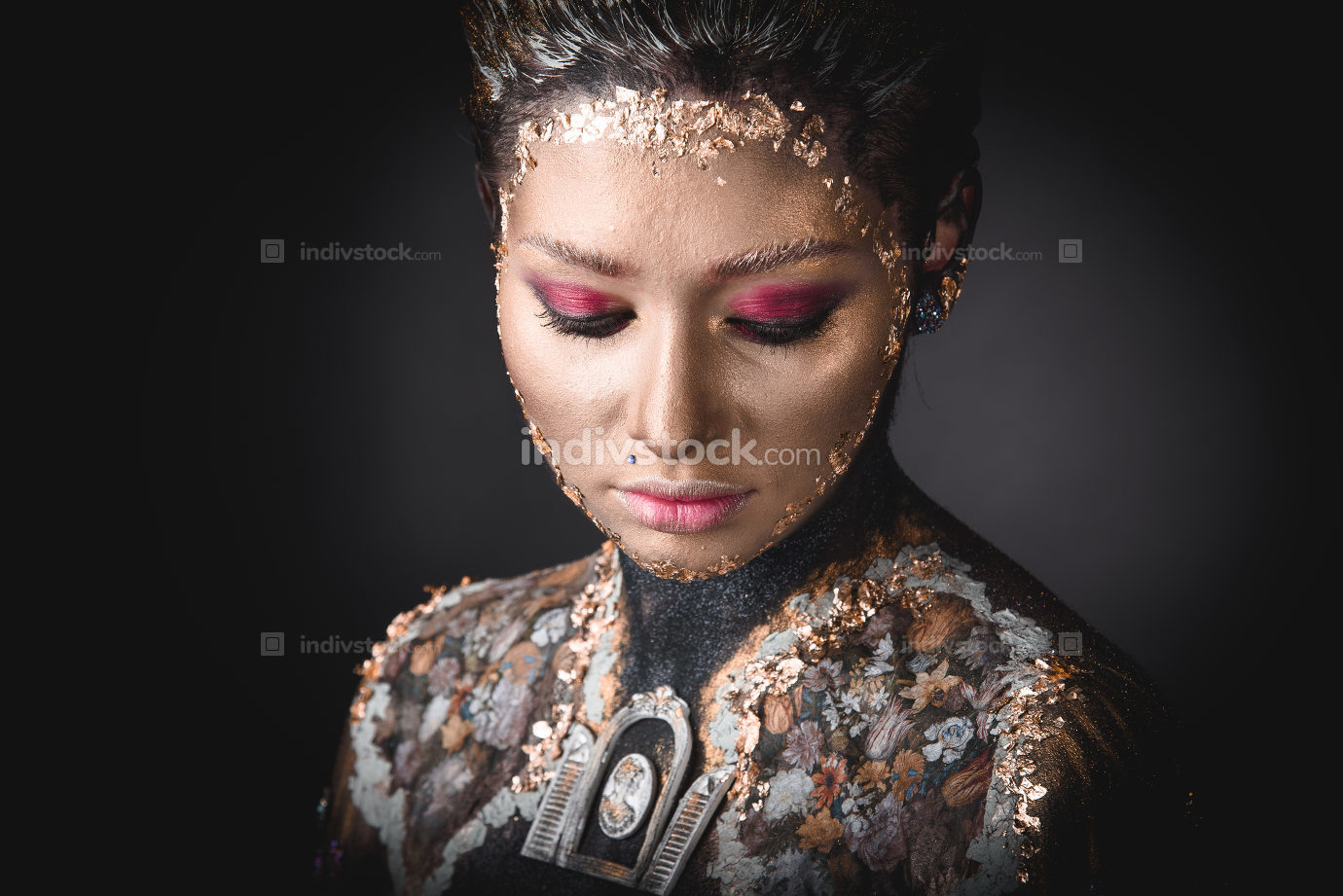 Portrait a girl with Golden icon painting makeup