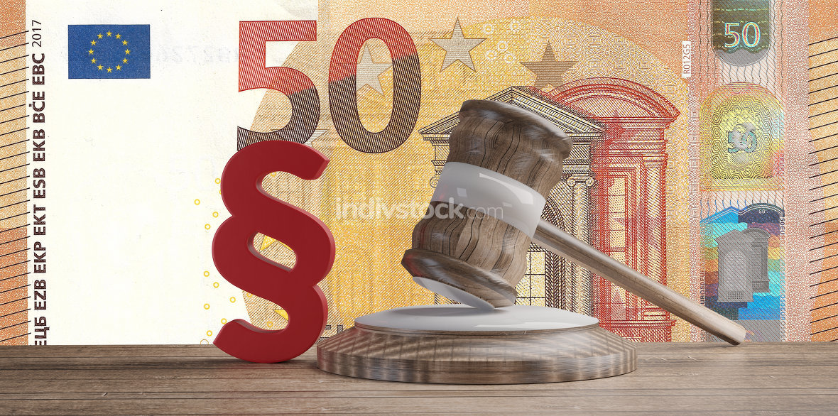 red paragraph and judge gavel in front of a fifty Euro banknotes