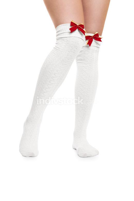 Sexy female legs in white stockings