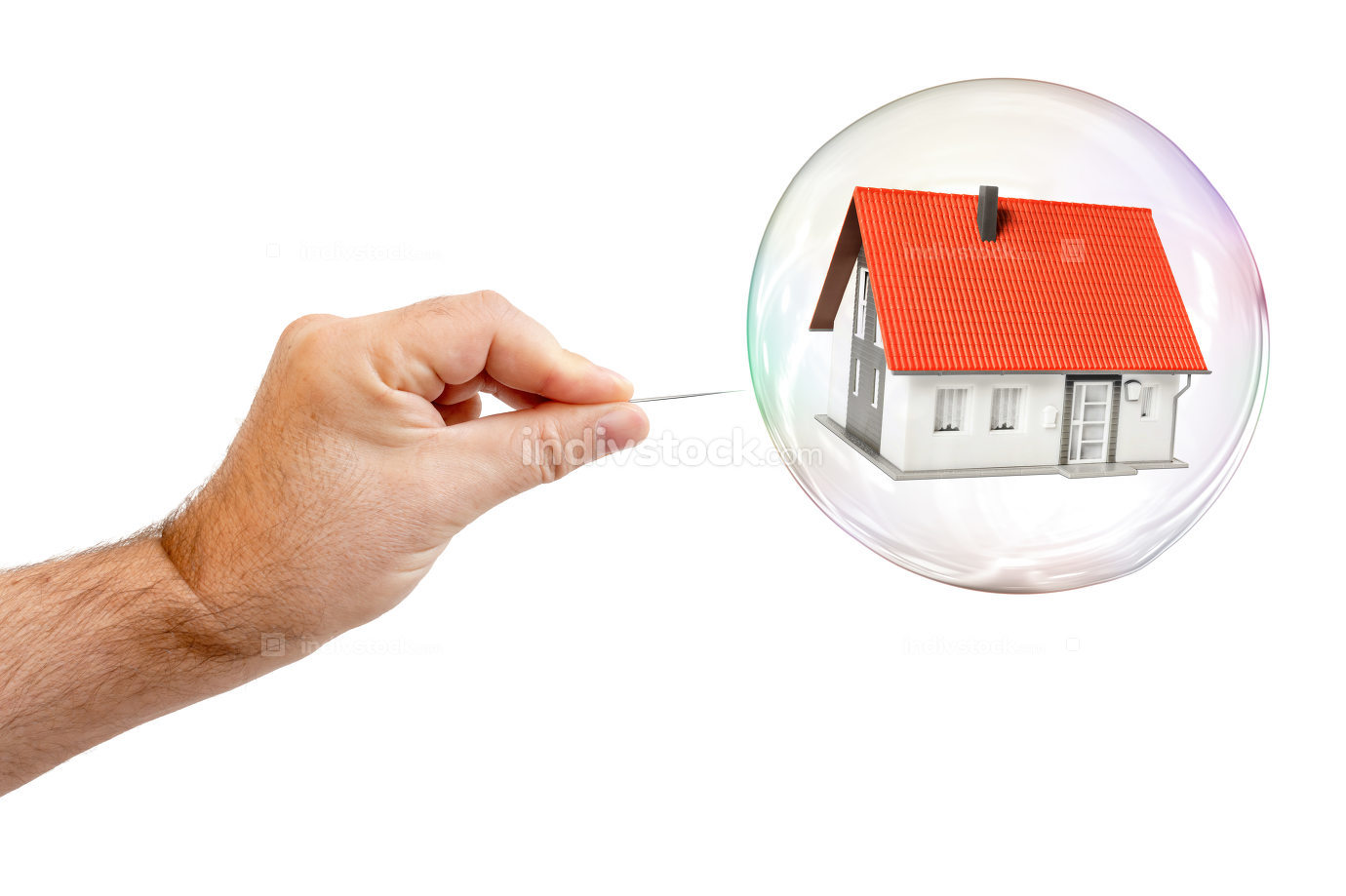 soap bubble with a house and a males hand with needle to let the