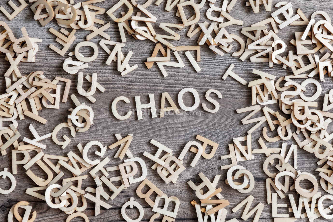 some wooden letters and the word chaos