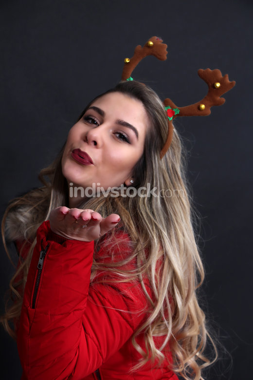 studio portrait of a girl with christmas headband in studio,
