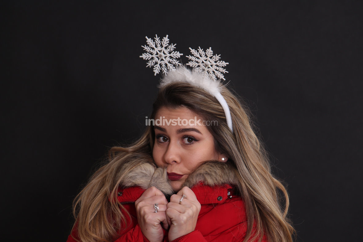 studio portrait of a girl with christmas headband in studio,