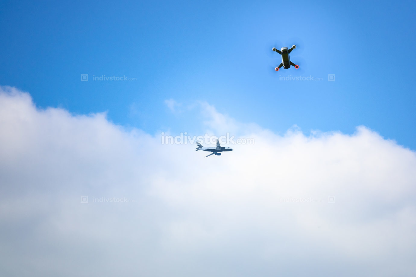 toy drone and airplane blue sky background
