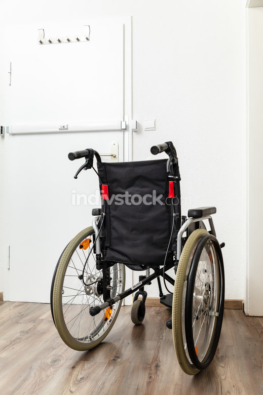 Wheelchair at an apartment door