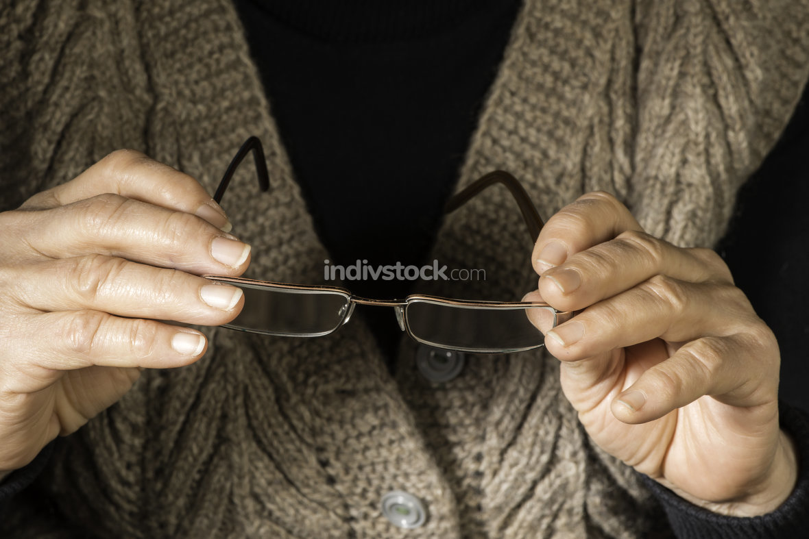 Women hands hold glasses