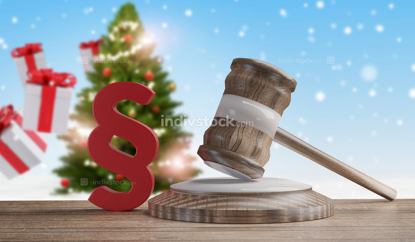 wooden judge gavel with red paragraph in front of blurred Christ