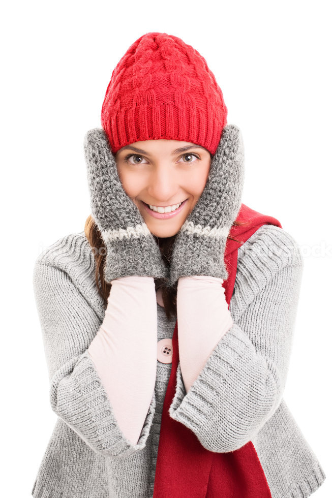 Young girl holding her head wearing winter clothes