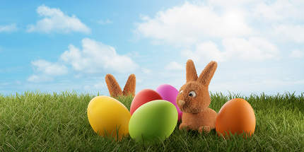 a small young cute Easter bunny and colored eggs 3d-illustration