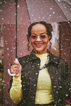 an african american woman under an umbrella