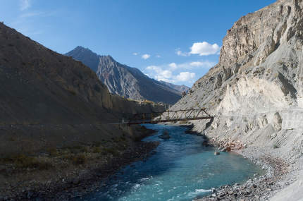 An old iron hanging suspension bridge Overpass Crossing over mountain river Kaza Himachal Pradesh India