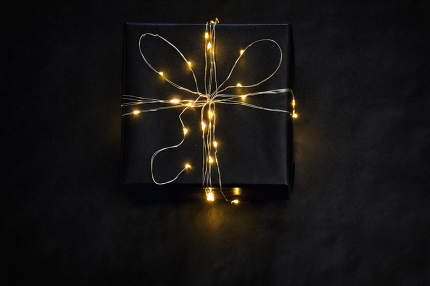 Black Present Box wrapped with string lights