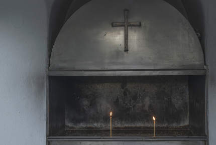 Burning candles in a church. Day light. Greece