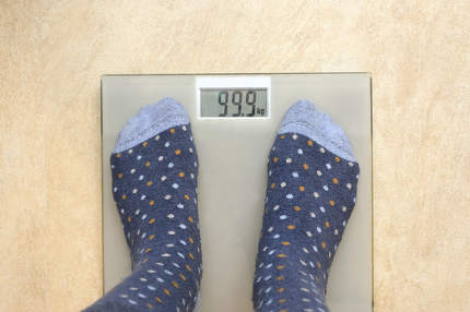 Closeup Of Feet In Socks On Weight Scale