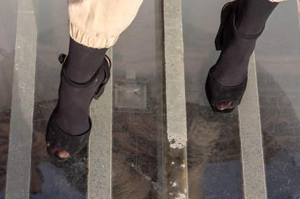 Close-up on womens legs on high heels
