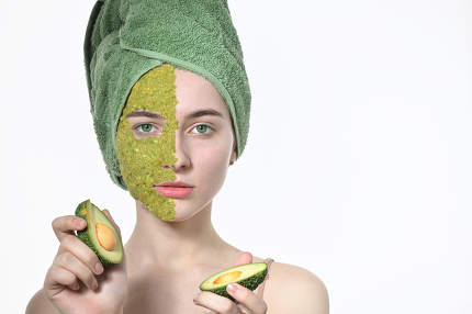 Cosmetics On Woman In Facial Mask With Avocado